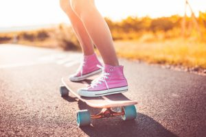 s_young-girl-with-pink-shoes-riding-a-longboard-picjumbo-com